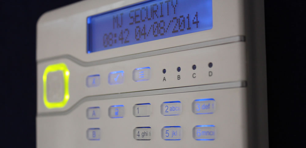 A close up of a burglar alarm system control panel